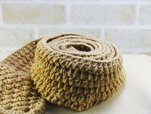 Warm knitted scarf female accessory with copy space background Royalty Free Stock Photo