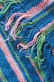 Warm knitted scarf with fringe Stock Photography