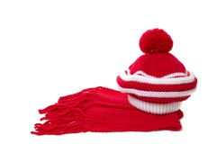 Warm knitted scarf and hat. Stock Images