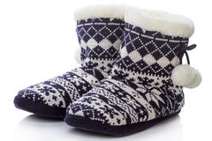 Warm knitted shoes Stock Photography