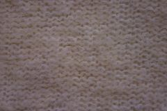 White knitted fabric. Royalty Free Stock Images