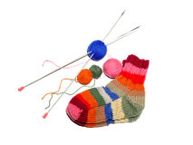 Warm knitted woolen socks knitting needles Royalty Free Stock Photos