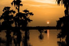 Warm lake martin sunset after a early evening shower royalty free stock images