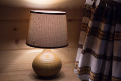 Warm lampshade of a yellow lamp Stock Image