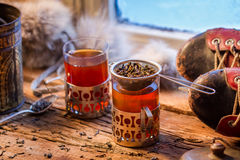 Warm leaf tea served in old-style Stock Image