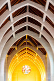 Warm Light on Altar Under Stone Arches Stock Photo