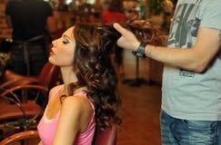 Warm light beauty shoot of brunette model in Beauty salon interior Royalty Free Stock Photos