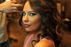 Warm light beauty shoot of brunette model in Beauty salon interior Royalty Free Stock Images