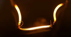 Warm light bulb isolated filament glow slow flashing. Light bulb isolated filament glow slow warm light flashing on black background 4k stock video