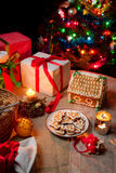 Warm light from the Christmas tree and candles Royalty Free Stock Images