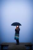 Warm light illuminates the face of lonely women Royalty Free Stock Photo
