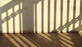 Warm light with shadows on wall. Stock Image