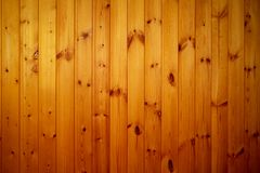 Wooden boards warm light. Warm lighted wooden boards yellow color interior stock photo
