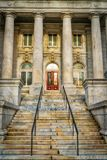 Warm Lighting Entrance to Methodist Church. Methodist church entrance with stairway up to the front door and pillars. Historical architecture in Washington DC stock photography
