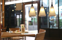 Warm lighting modern ceiling lamps in the cafe. Royalty Free Stock Image