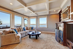 Warm living room interior in luxury house with Puget Sound view Stock Image