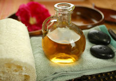 Warm massage oil. Alternative therapy with warm massage oil Stock Photography