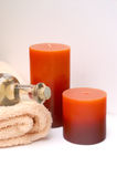 Warm Massage Treatment. Massage oil and relaxing spa candles for a soothing massage treatment Stock Photos