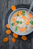 Warm meal mushroom soup carrots parsley wooden table Stock Images