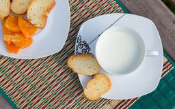 Warm milk in the white cup Stock Photos