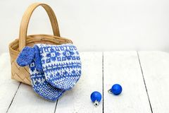 Warm mittens, basket and blue balls Royalty Free Stock Photo