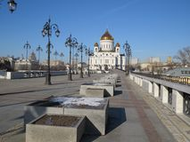 Warm mood of a cold winter on the Patriarchal bridge in Moscow near Christ the Savior Cathedral royalty free stock photo