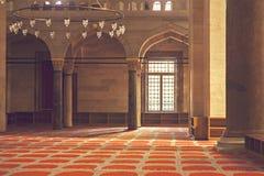 Warm mosque interior Stock Photos