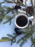 Warm mug of tea outdoors on a snow background royalty free stock photos