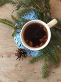 Warm mug of tea outdoors in the winter time stock images