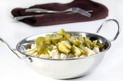 Warm pasta salad with gherkin Royalty Free Stock Images