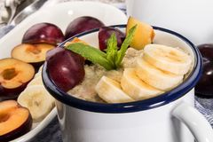 Warm porridge, scottish breakfast with plum and banana stock photo