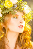 Warm portrait of sensual woman with flowers royalty free stock images