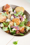 Warm potatoe salad with lamb's lettuce Royalty Free Stock Photo