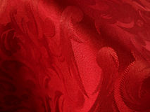 Warm red fabric. Warm deep red fabric closeup royalty free stock photos