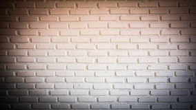 Warm red Spotlight on brick wall with dark corner Royalty Free Stock Photos