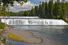 Warm river waterfalls. Many waterfalls and cascades are to be found in and around the surrounding areas of Yellostone and Grand Teton national parks Royalty Free Stock Images