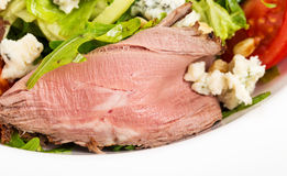 Warm roast beef salad with goat cheese. Royalty Free Stock Photos