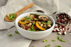 Warm salad with beans, mushrooms and bell peppers Royalty Free Stock Photo
