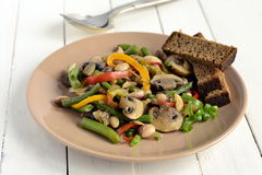 Warm salad with beans, mushrooms and bell peppers Stock Photos