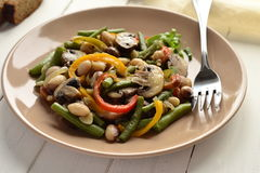 Warm salad with beans, mushrooms, peppers Royalty Free Stock Image