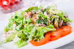 Warm salad with beef and herbs Stock Photo
