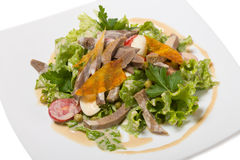 Warm salad with beef tongue, with quail eggs Royalty Free Stock Photography