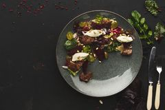 Warm salad with beetroot and cheese served at restaurant royalty free stock image