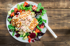 Warm Salad from Brown Rice, Quinoa, Prawns, Halloumi and Veg Stock Images