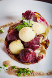 Warm salad of celery and beetroot 02. Warm salad of celery and beetroot, baked with nuts vinaigreta Stock Photography