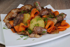 Warm salad with chicken hearts Stock Image