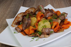 Warm salad with chicken hearts Stock Photos