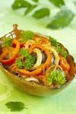 Warm salad from chicken liver. Pepper, carrots and onions with greens Royalty Free Stock Photo