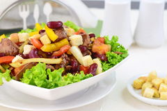 Warm salad with chicken liver, beans, tomatoes, sweet paprika, croutons and balsamic dressing.. Stock Image