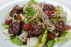 Warm salad with chicken liver and grapes Royalty Free Stock Image